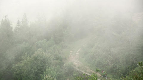 Man Riding Motorbike In Mist, At Himalayas stock footage