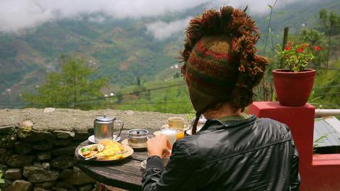 Woman wearing funny hat eating breakfast Footage