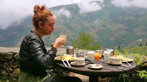 Female tourist eating breakfast Footage