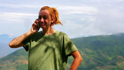 Female tourist using mobile phone on top of mounta Footage