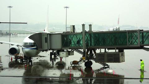 passengers walking on boarding bridge at airport j Footage