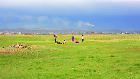 Mongolian Kids are playing at steppe Footage