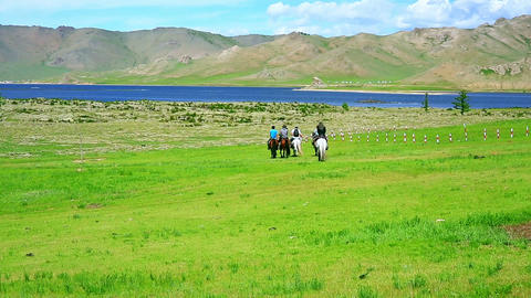 People riding horses in Mongolian landscape Footage