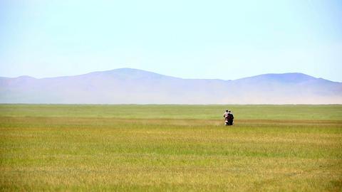 motorbike riding in Mongolian landscape Footage