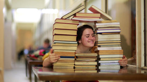 Girl gazing through books Footage