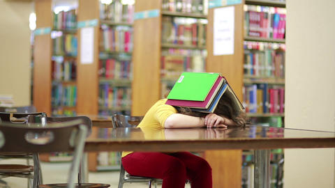 Girl buried under book stack Live Action