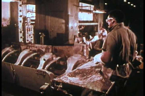 A Ford automobile factory assembly line in 1974 as Footage
