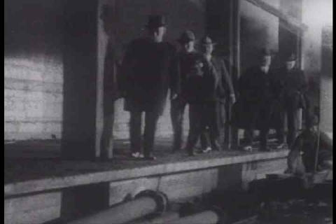 Silent film from 1917 depicting men working in a m Footage