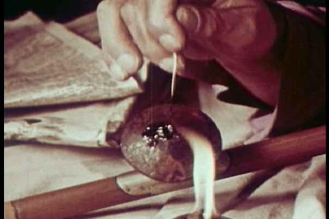 Black opium is smoked in this 1951 drug prevention Footage