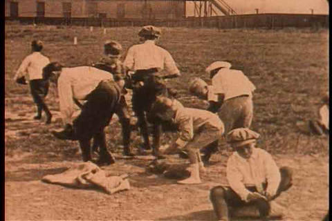 Boys get dressed for a baseball game in this 1928  Footage