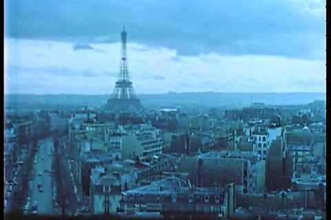 An archival shot of Paris in the 1950's Live Action