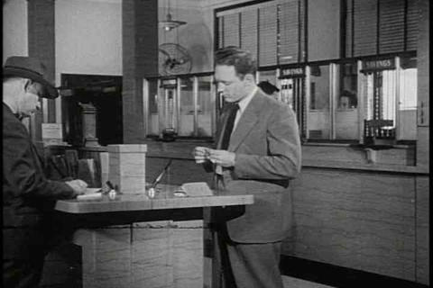Mr. Adams goes to the bank in 1947 Stock Video Footage