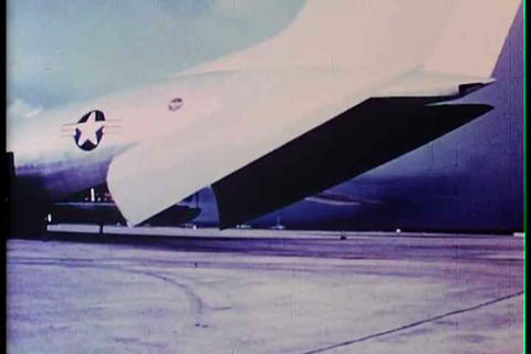 Air Force Personnel Unload A Cargo Plane During Th stock footage