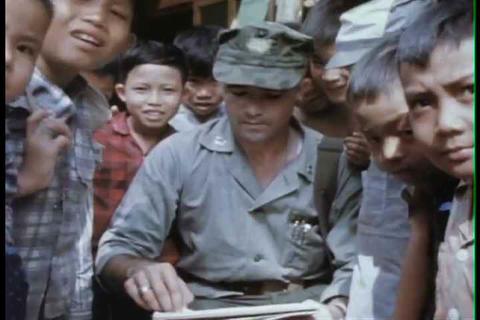 A combat artist draws pictures of village children Footage