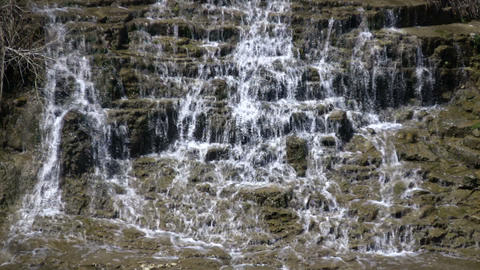 Water flows down the jagged rocks, creating waterfalls... Stock Video Footage