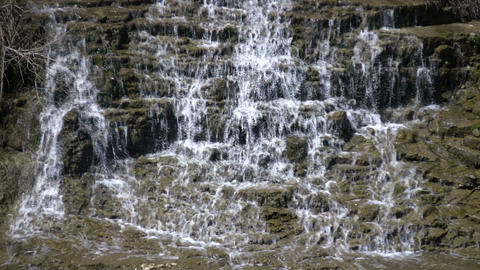 Water flows down the jagged rocks, creating waterfalls (High Definition) Footage