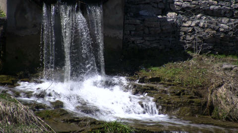 Water falls on jagged rocks, creating small waterfalls... Stock Video Footage