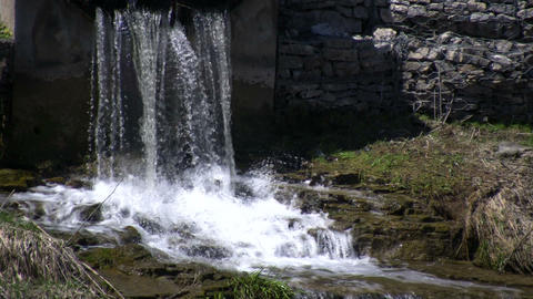 Water falls on jagged rocks, creating small waterfalls (High Definition) Footage