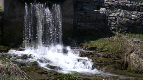 Water falls on jagged rocks, creating small waterfalls... Stock Video Footage
