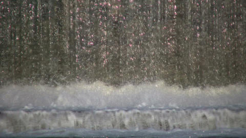 Closeup of waterfall as it breaks into river (High... Stock Video Footage