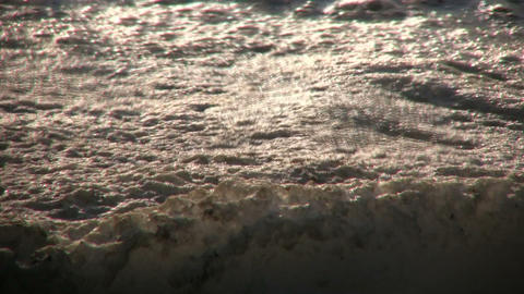 Closeup of drifting foam created by a waterfall (High... Stock Video Footage