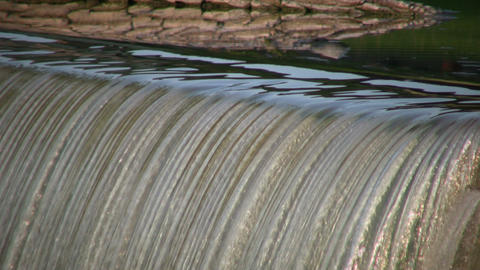 Closeup of waterfall flowing over edge in lines (High Definition) Footage