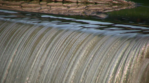 Closeup of waterfall flowing over edge in lines (High... Stock Video Footage
