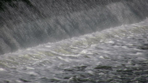 Water flows over a weir, creating small waterfall (High Definition) Footage