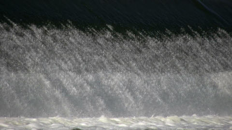 Closeup of waterfall as it breaks into river (High Definition) Footage
