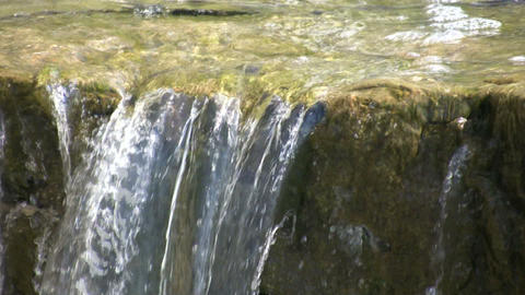 Closeup shot of water flowing over the edge (High Definition) Footage