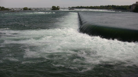 water's is turbulent as it flows over weir (High Definition) Footage