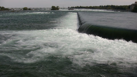 water's is turbulent as it flows over weir (High Definition) Stock Video Footage