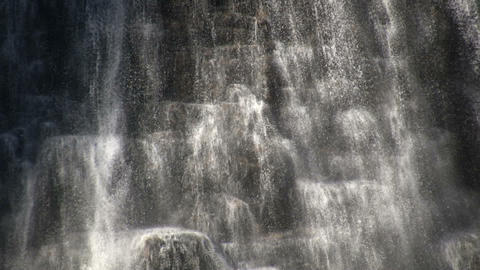 Close-up of water flowing down a rock wall (High Definition) Footage