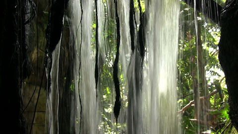 Closeup of a small waterfall from behind Stock Video Footage