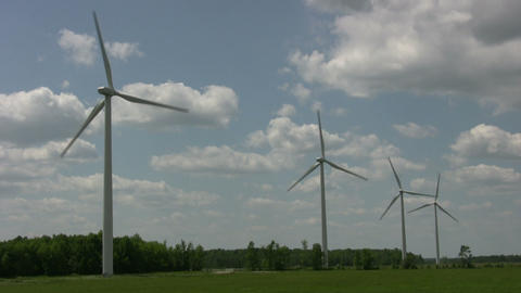 Wind turbines spin amidst a cloudy sunny day (High Definition) Footage