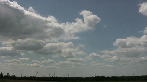 Wind turbines spin amidst a cloudy sunny day (High Definition) Live Action