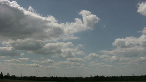 Wind turbines spin amidst a cloudy sunny day (High... Stock Video Footage