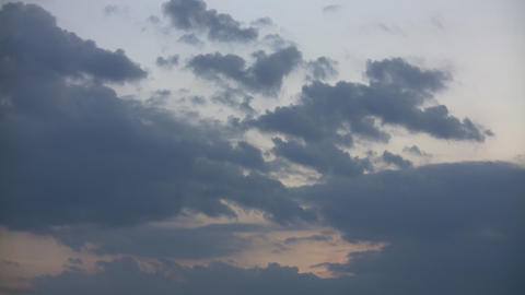 Beautiful timelapsed clouds slowly drift along at dusk... Stock Video Footage