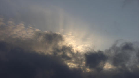 Clouds and Sunrays Stock Video Footage