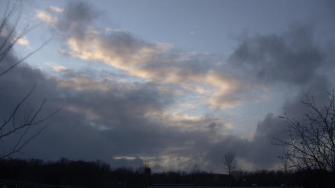 Beautiful timelapsed clouds slowly drift along at dusk (High Definition) Footage