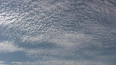 Timelapsed clouds quickly drift amidst a blue sky (High... Stock Video Footage