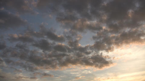 Timelapsed clouds slowly drift at dusk (High Definition) Footage