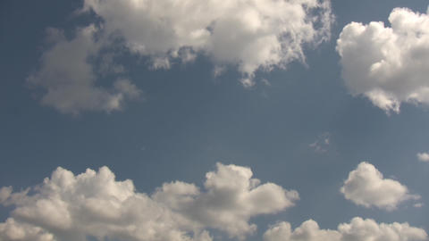 Timelapsed clouds quickly drift amidst a blue sky (High Definition) Footage