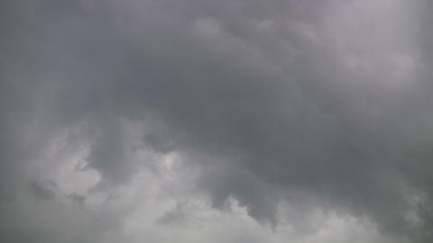 Dark clouds slowly drift in the gloomy sky (High Definition) Stock Video Footage