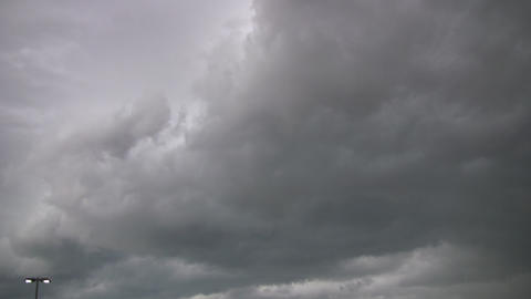 Dark timelapsed clouds drift by, brewing a storm (High... Stock Video Footage