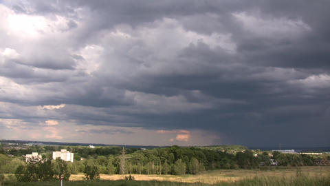 Dark timelapsed rain clouds slowly drift by (High... Stock Video Footage