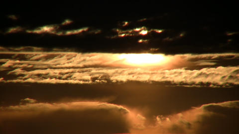 Morning scenic of a sunrise admist the clouds (High... Stock Video Footage