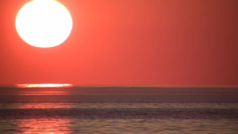 Scenic of a beautiful sunset over the water (High... Stock Video Footage
