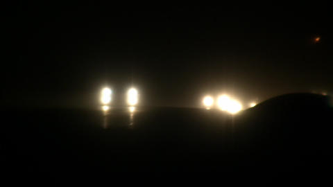 Headlights on busy highway at night (High Definition) Stock Video Footage