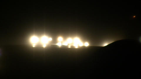 Headlights on busy highway at night (High Definition) Footage